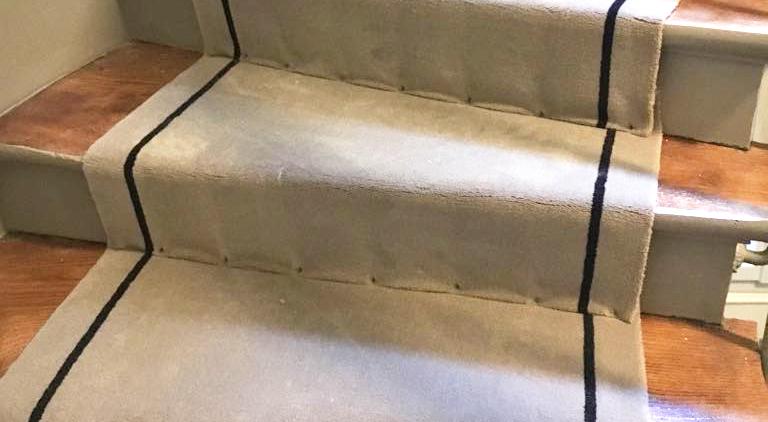 Pose tapis cloué