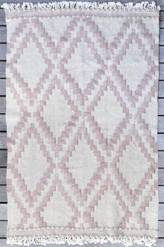 tapis d'intérieur géométrique rose et blanc