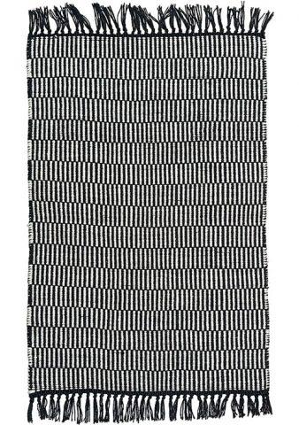 tapis géométrique noir et blanc avec franges